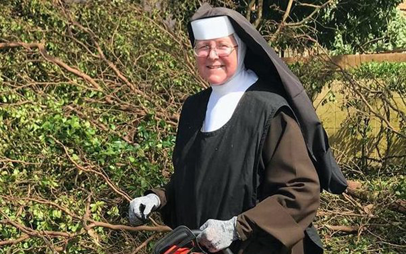 Carmelite Sister Margaret Ann, principal of Archbishop Coleman Carrol High School in Miami, holds the chainsaw she used to help clean up debris following Hurricane Irma.