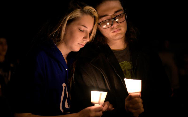 A man and woman attend a candlelight vigil after a mass shooting Nov. 5 at the First Baptist Church in Sutherland Springs, Texas. A lone gunman entered the church during Sunday services taking the lives of at least 26 people and injuring several more.