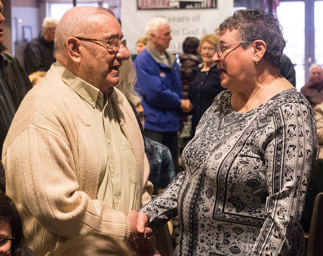 <p>Paul and Pauline Mangione renew their marriage vows April 14 at St. Christopher Church in North Chili as part of the parish's 50th-anniversary celebration. (Courier photo by John Haeger)  </p>