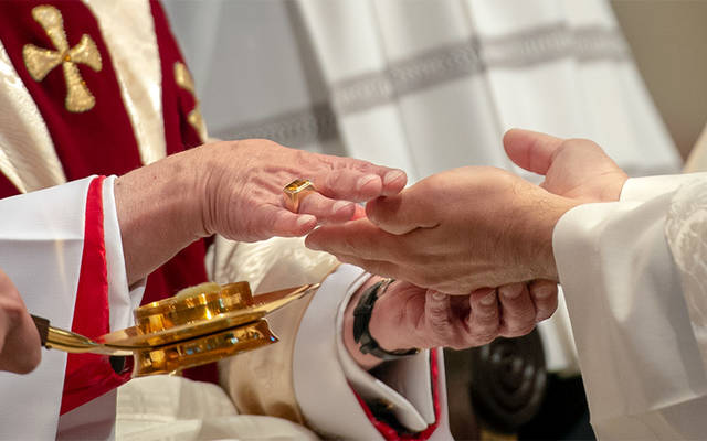 <p>Father Jeff Chichester's hands are anointed by Bishop Salvatore R. Matano during the new priest's ordination Mass June 2 at Sacred Heart Cathedral. (Courier photo by Jeff Witherow) </p>