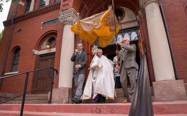 <p>Bishop Salvatore R. Matano exits Rochester's St. Stanislaus Kostka Church to begin a eucharistic procession around the church grounds after the June 3 closing Mass for the diocesan Year of the Eucharist. (Courier photo by Jeff Witherow)  </p>