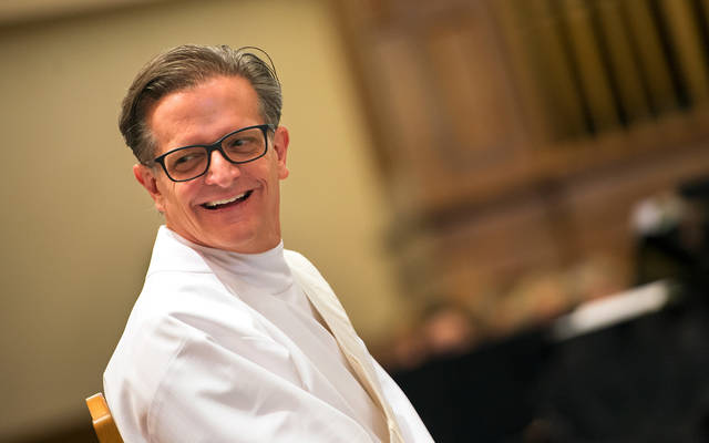 <p>Father Kevin Mannara smiles at his family members during his ordination as a Basilian priest Aug. 5 at Rochester's St. Mary Church.