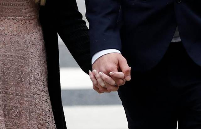 Connie Yates and Chris Gard hold hands as they arrive at the High Court in London July 24. Pope Francis is praying for the parents of Charlie Gard after a U.S. doctor told them nothing could be done to help their son who suffers from encephalomyopathic mitochondrial DNA depletion syndrome.