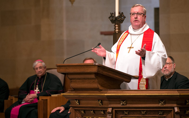 Bishop Salvatore R. Matano (left) and other clergy look on as Bishop John Macholz of the Upstate New York Synod of the Evangelical Lutheran Church in America speaks during a joint Catholic-Lutheran prayer service at Rochester's Sacred Heart Cathedral Oct. 29. (Courier photo by Jeff Witherow)