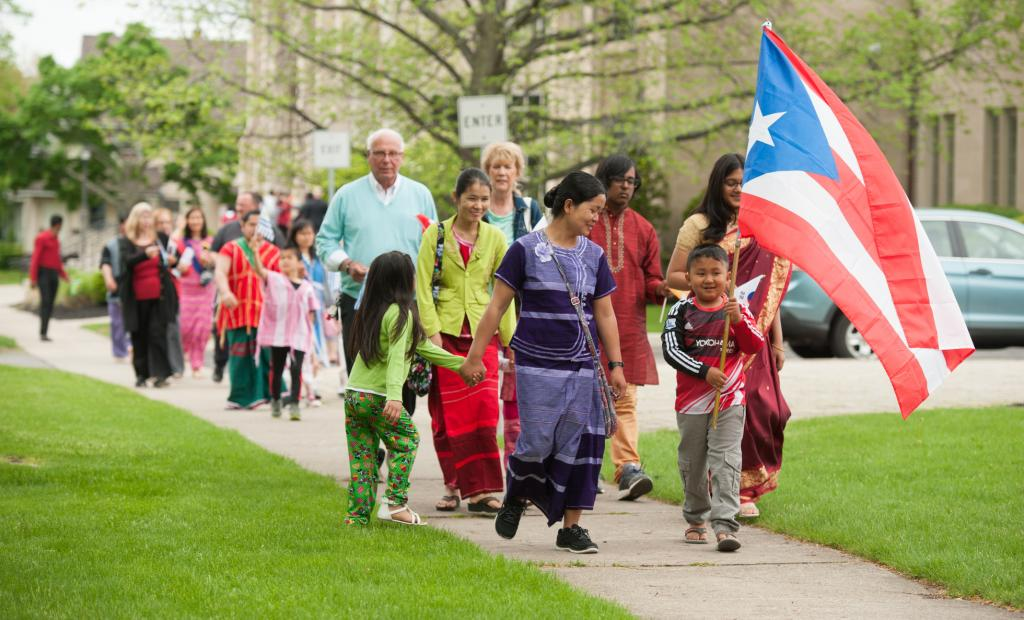 Eight-year-old Neyry Oo (right) carries the Puerto Rican.