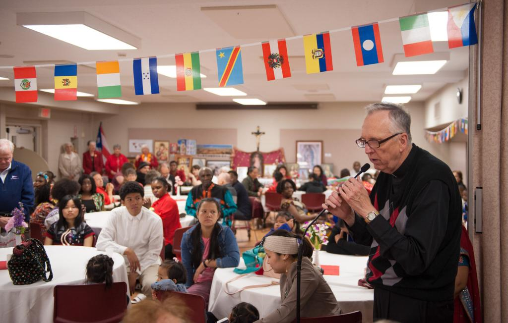 Father Kevin McKenna says a prayer before the luncheon.