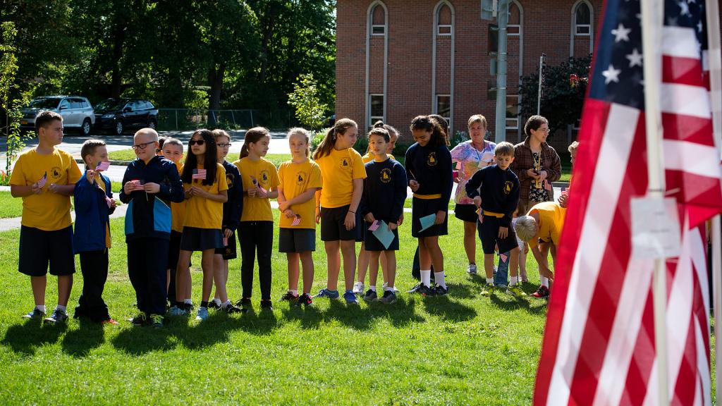 A class of St. Mary School students lines up near the Field of Honor.