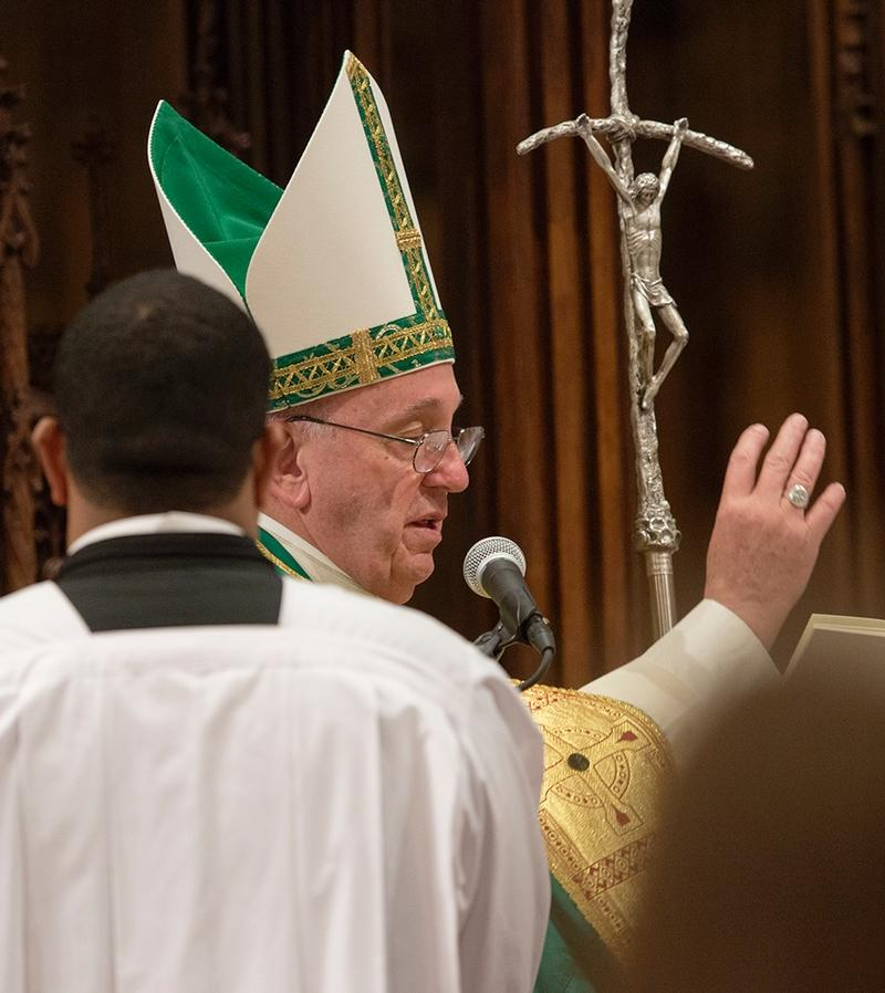 Pope Francis blesses the newly-renovated St. Patrick's Cathedral in New York at the end of his Sept. 24 prayer service at the cathedral.