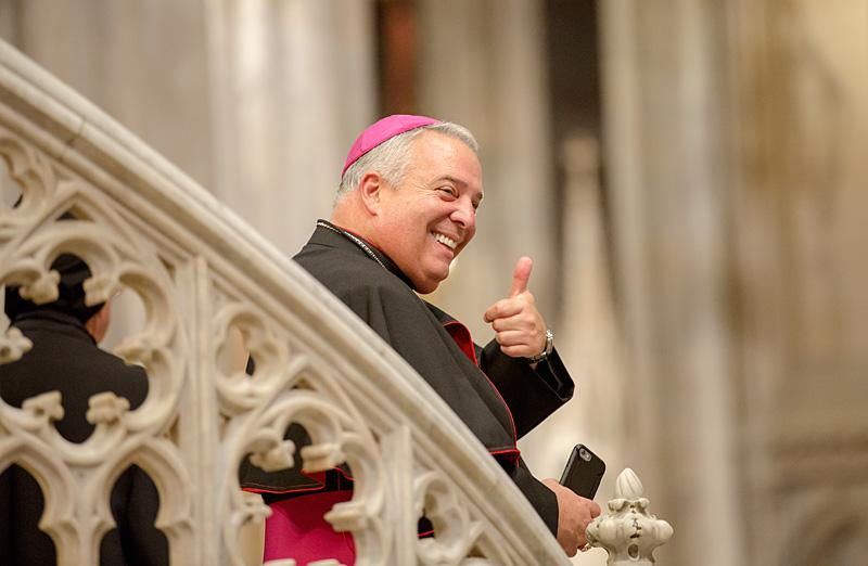 Bishop Nelson Perez, Auxiliary Bishop of Brooklyn, give the thumbs-up sign after the evening prayer service at St. Patrick's Cathedral.