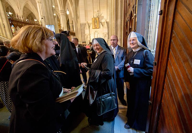 Nuns arrive for an evening prayer service led by Pope Francis at St. Patrick's Cathedral Sept. 24.