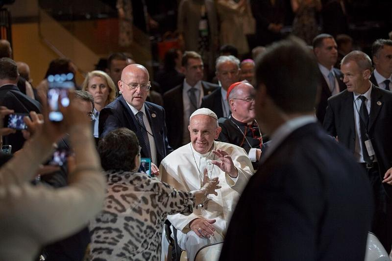 A woman reaches out to Pope Francis as he greets the crowd before celebrating Mass at Madison Square Garden in New York Sept. 25.