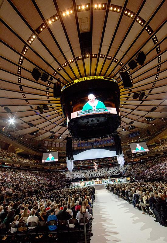 Pope Francis appears on the jumbotron as he celebrates Mass at Madison Square Garden Sept. 25.