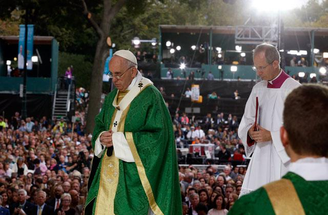 Pope Francis walks to seat after delivering homily during closing Mass of VIII World Meeting of Families in Philadelphia