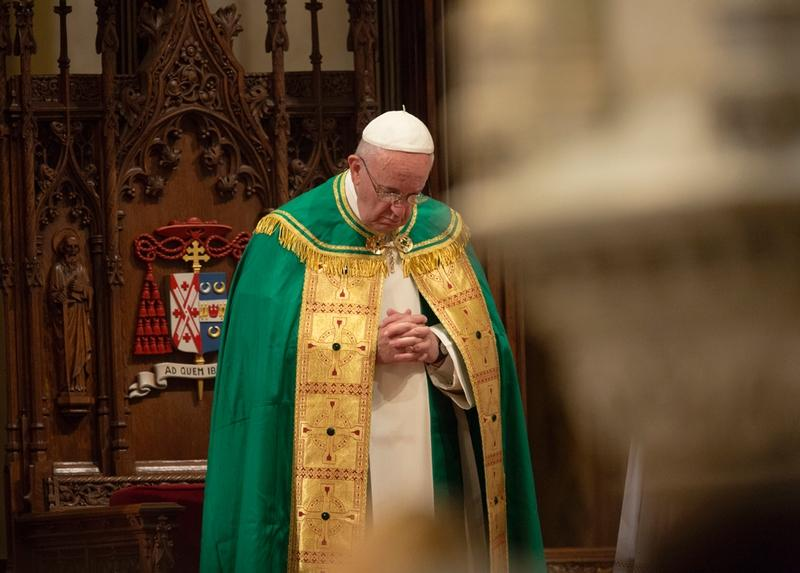 Pope Francis bows his head in prayer during an evening prayer service at St. Patrick's Cathedral in New York Sept. 24.