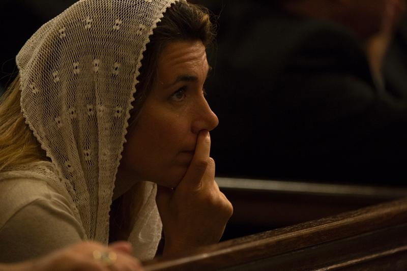 A woman attends an evening prayer service celebrated by Pope Francis at St. Patrick's Cathedral in New York Sept. 24.