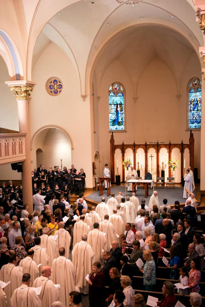 Basilian and diocesan priests process into Rochester's St. Mary Church at the start of Father Kevin Mannara's Aug. 5 ordination Mass.