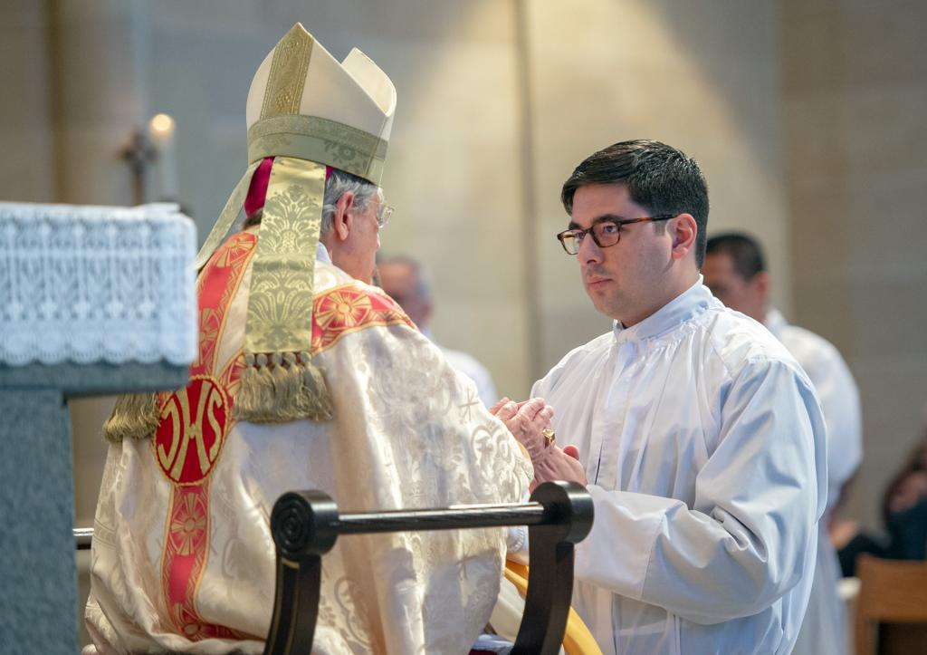 Deacon Daniel White pledges his obedience to Bishop Matano.