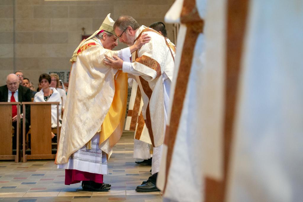 Bishop Matano congratulates Deacon James Pegoni.