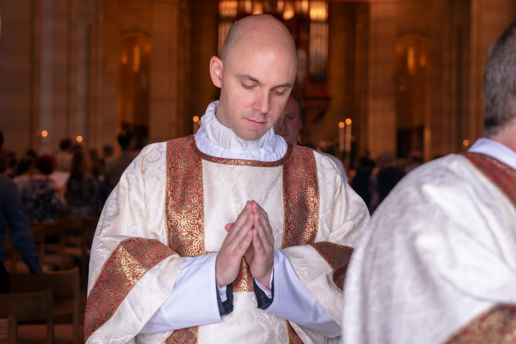Deacon Matthew Walter recesses out of the cathedral at the end of Mass.
