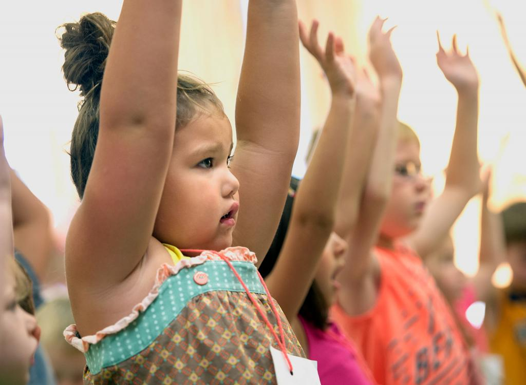 Zoe Trout sings a song July 19 during vacation Bible school at St. Francis and St. Clare Parish in Waterloo.