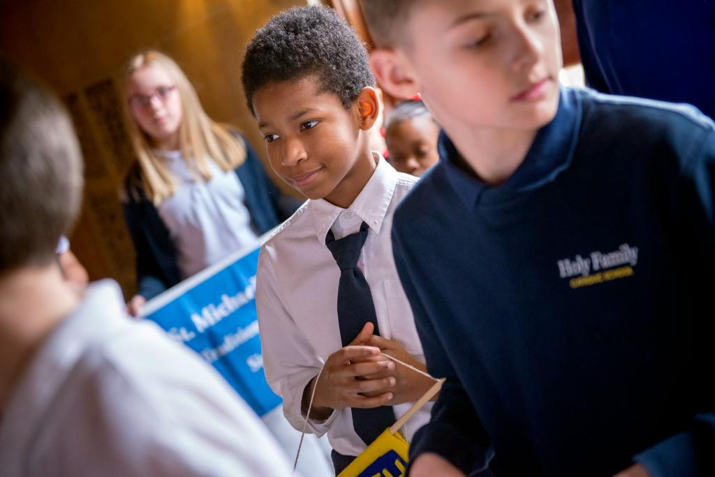 Sixth-grader Marcqell Freeman of Rochester's Nazareth Elementary School waits to process into Sacred Heart Cathedral at the start of a Jan. 31 Mass celebrating Catholic Schools Week. Bishop Salvatore R. Matano celebrated the Mass.