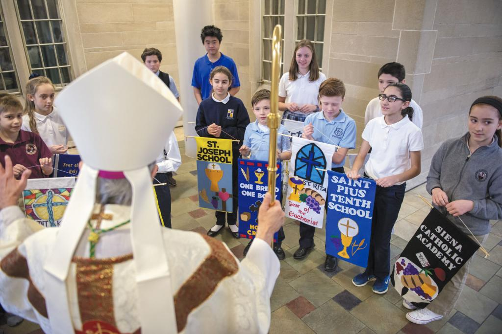 Bishop Matano speaks to students from diocesan Catholic schools before a Jan. 31 Mass celebrating Catholic Schools Week.
