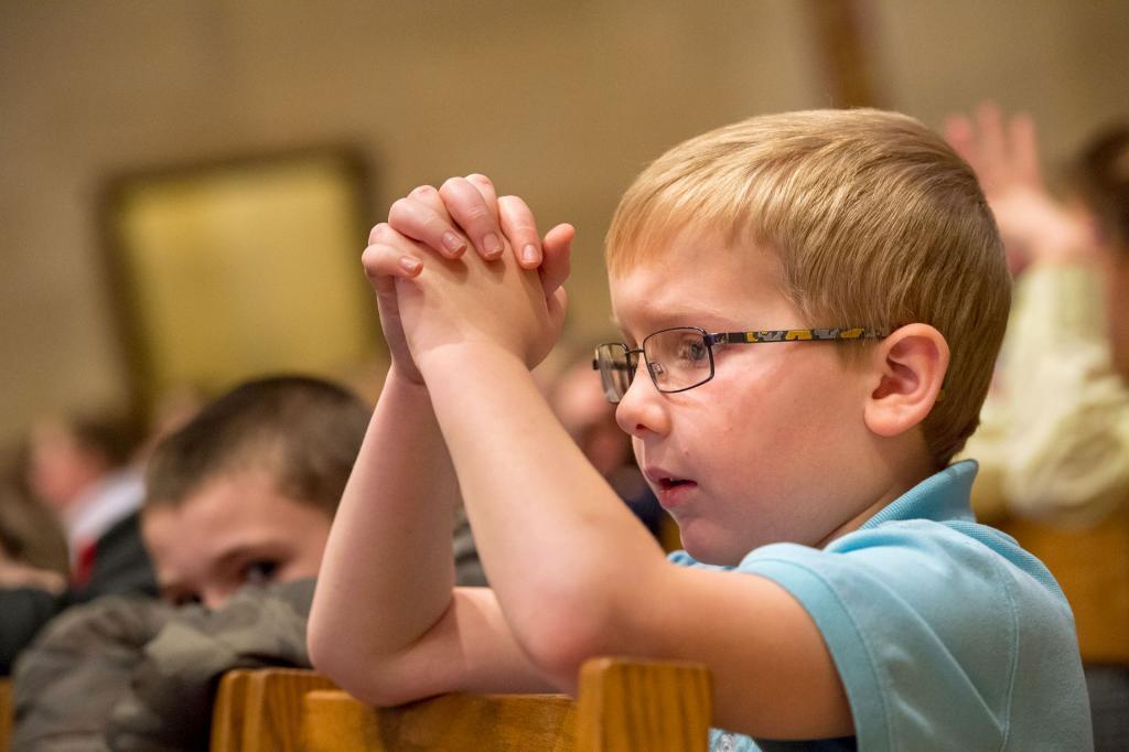 Third-grader Matt O'Neil from Canandaigua's St. Mary School kneels during the Jan. 29 Catholic Schools Week Mass.
