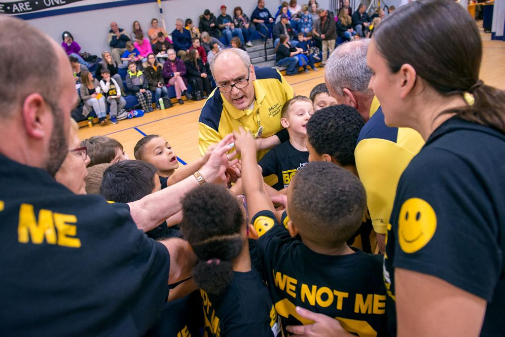 Ed DiPonzio fires up the Holy Cross School second-grade CYO basketball team before a Jan. 29 game celebrating Catholic Schools Week. All proceeds from the game went to the Ashley Nagel Preschool Scholarship Fund, founded in memory of a Holy Cross preschooler who died of a brain tumor in 2013.