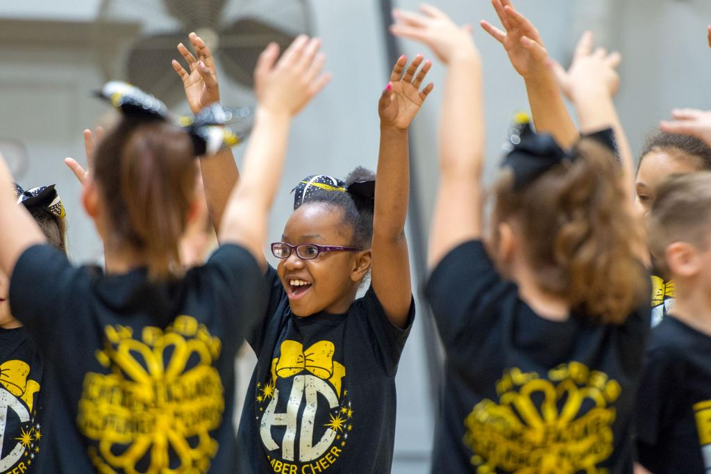 Avionna Grayson cheers on basketball players at the start of a Jan. 29 CYO basketball game at Holy Cross School in Rochester.