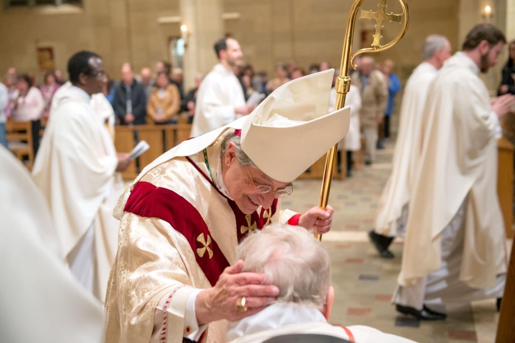 Bishop Matano greets Father Thomas Wheeland during the recession.