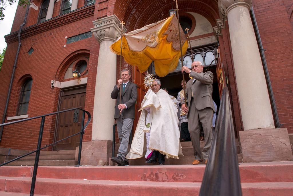 Bishop Salvatore R. Matano exits Rochester's St. Stanislaus Kostka Church to begin the eucharistic procession around the church.