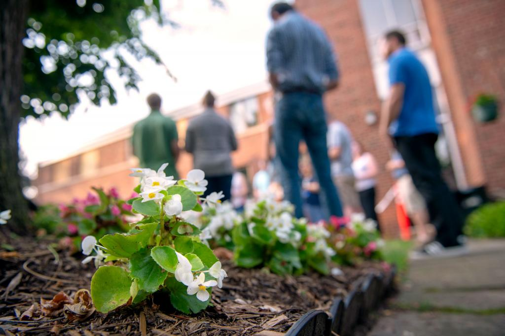 Young adults pray the rosary in the Fr. Edward Zimmer Memorial Garden.