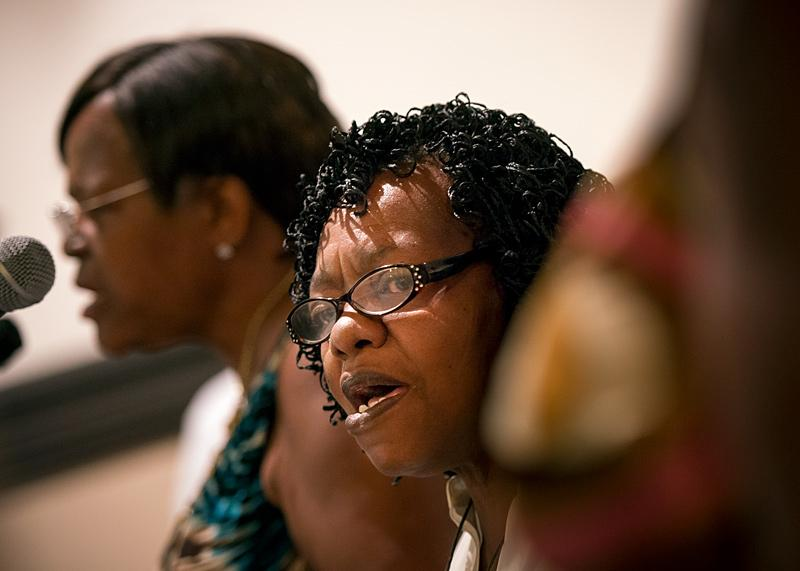 Mary Jane Dunbar (right) and Sarah Graham (left) sing in the House of Mercy's Gospel choir during the service.