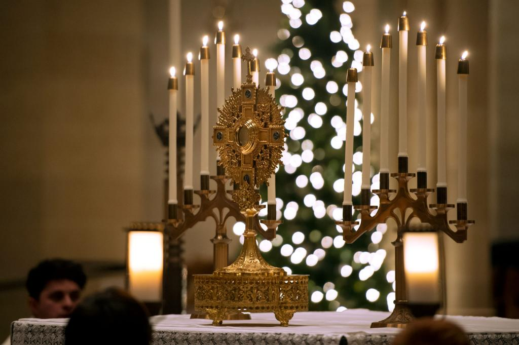 The monstrance is placed on the altar during the celebration.