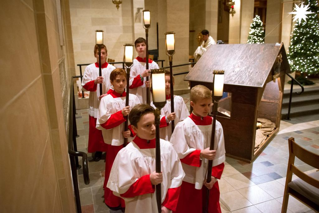 Altar servers process toward the altar.