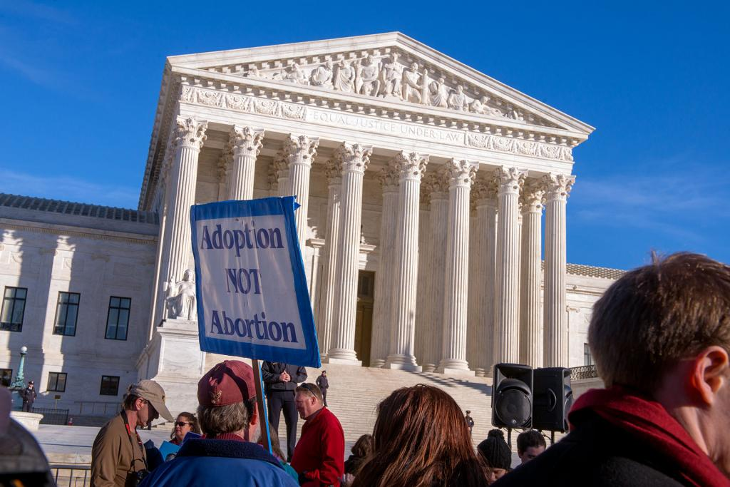 Protesters rally outside the Supreme Court at the end of the march.
