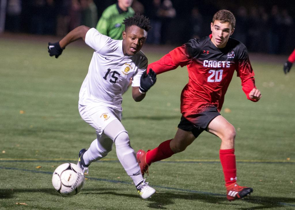 McQuaid's Dominic Duncan (left) runs the ball as he is defended by Hilton's Aaron Masters (right).