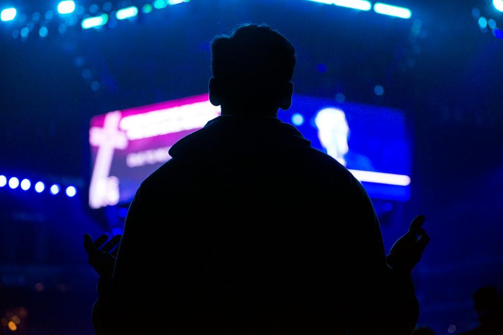 A teen extends his hands during a performance by Matt Maher Nov. 17.