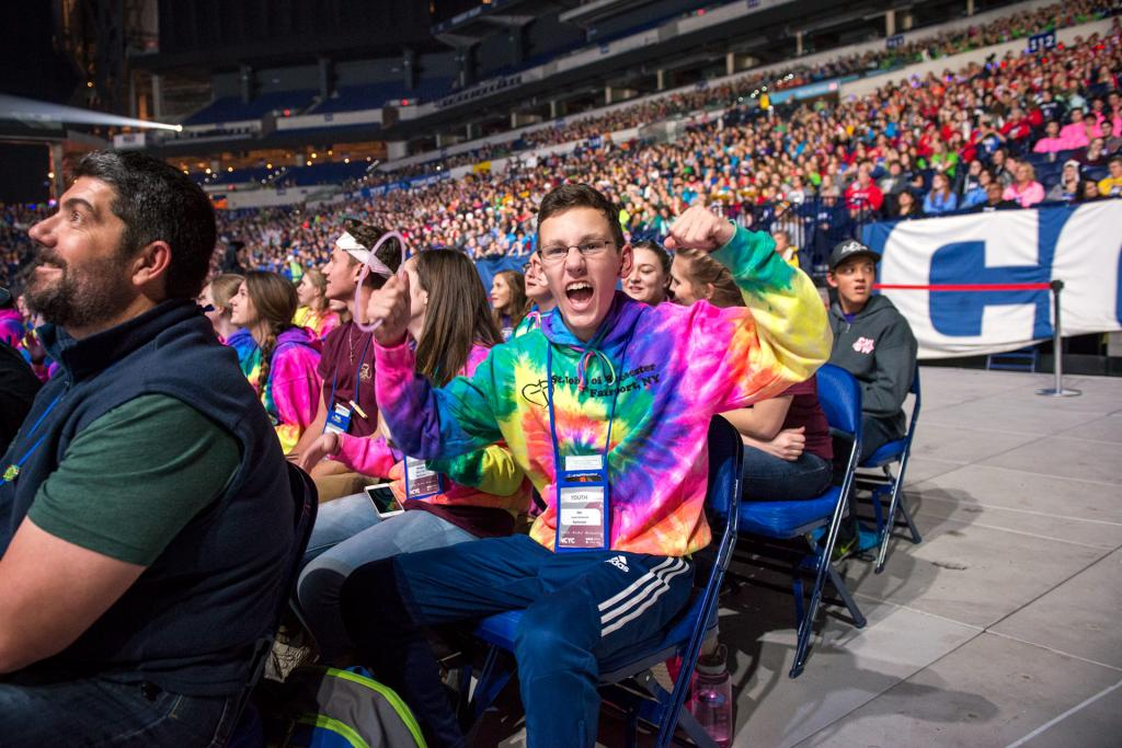 Joe McDonald cheers during the opening ceremony Nov. 16.