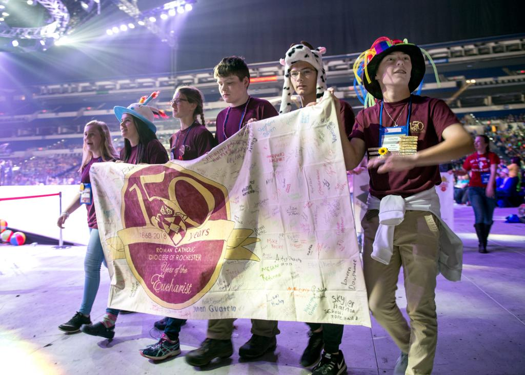 The Diocese of Rochester banner is carried into the arena during the opening ceremony Nov. 16.