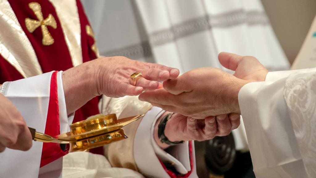 Father Jeffrey Chichester's hands are anointed by Bishop Matano.