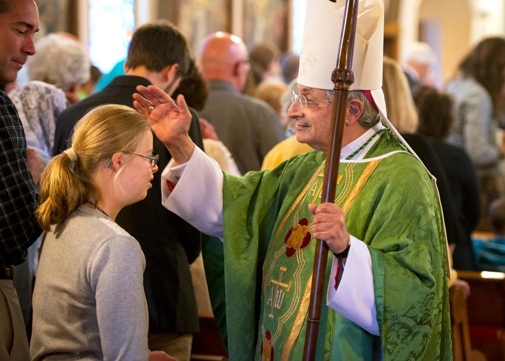 Bishop Salvatore R. Matano blesses Teresa Flugel at the end of the Oct. 1 Respect Life Sunday Mass at Rochester's Our Lady of Victory/St. Joseph Church.