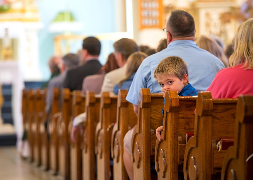 Isaac Angelo DeMartino sits during the Mass.