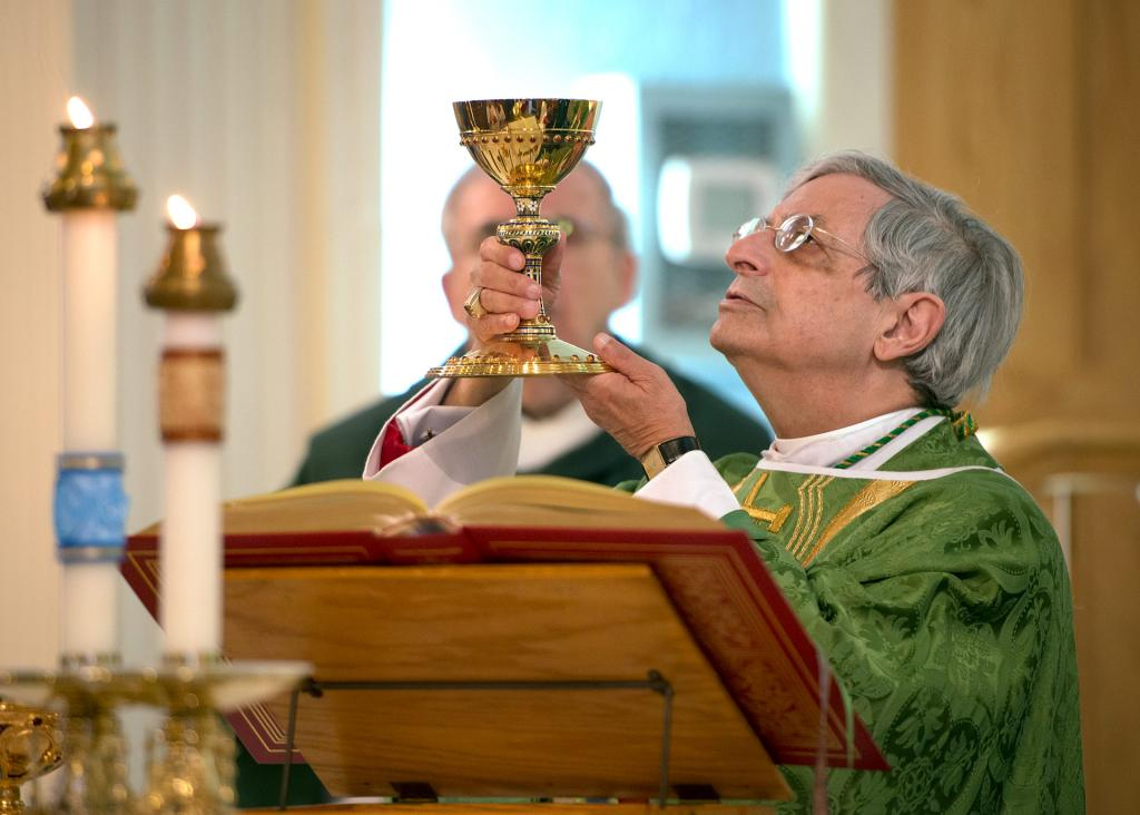 Bishop Matano elevates the chalice.