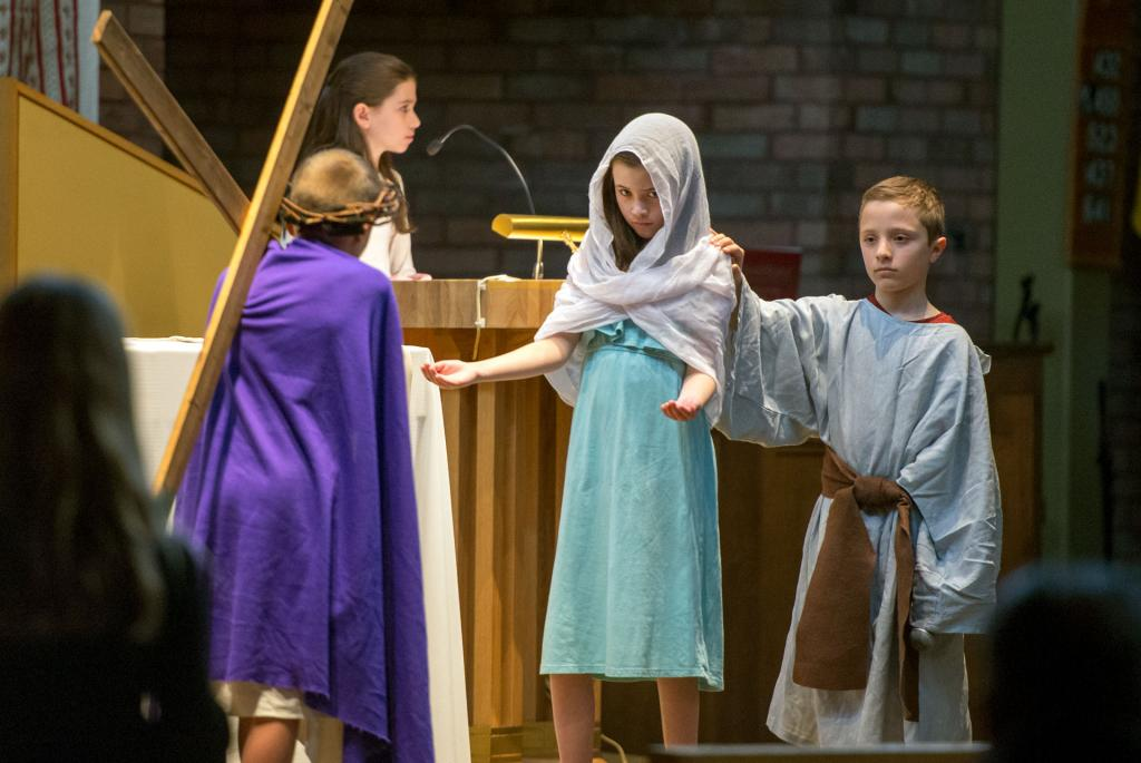 Jesus is met by Mary and John, played by Katie Rayburn and Jay Buzzelli.