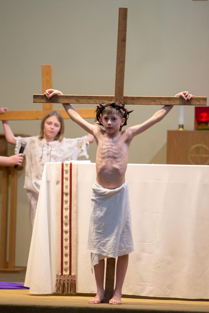 Jesus, played by Ben Dodds, hangs on the cross.