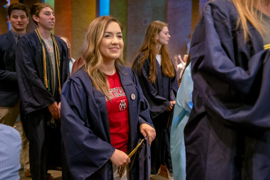 Isabella Ortega, who is graduating from Pittsford Sutherland High School, recesses from the prayer service with her former St. Louis classmates.