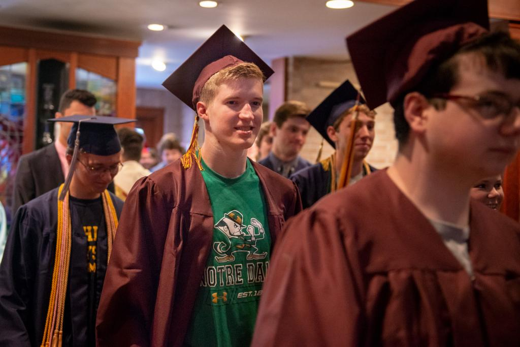 David Petrison, who is graduating from Pittsford Mendon High School, processes into the prayer service.