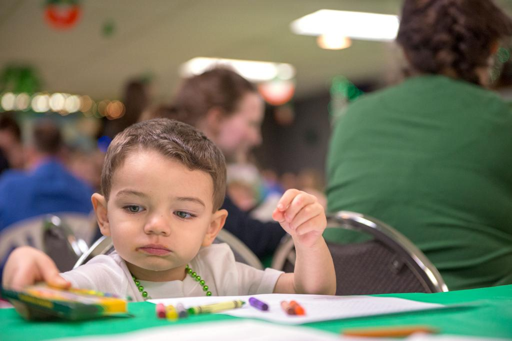 Two-year-old Jerry Reyes colors a picture before dinner during the annual St. Patrick's Day celebration at St. Paul of the Cross Churchin Honeoye Falls March 10. (Courier photo by Jeff Witherow)