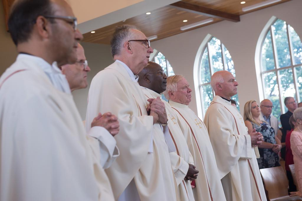 Members of the clergy look on during the first Mass in the new Hermance Family Chapel of St. Basil the Great at St. John Fisher College Sept. 17.